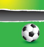 Soccer ball on ripped banner Royalty Free Stock Photos
