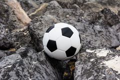 Soccer ball on rock Royalty Free Stock Photos