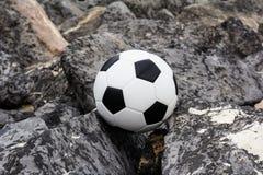 Soccer ball on rock Royalty Free Stock Photos