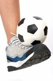 Soccer ball on rubber shoes Royalty Free Stock Photos