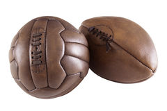 Soccer ball and rugby ball. On white background stock photography