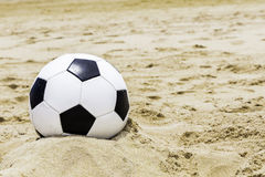 Soccer ball on the sand Royalty Free Stock Images