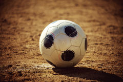 Soccer ball on sand field Stock Photo