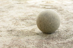 Soccer ball on the sand. Old soccer ball on the sand Stock Photo