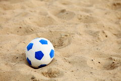 Soccer ball on sandy beach background Royalty Free Stock Photo