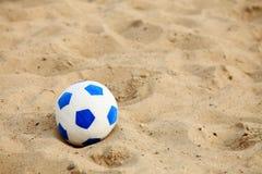 Soccer ball on sandy beach background Royalty Free Stock Photo
