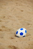 Soccer ball on sandy beach background Stock Photos