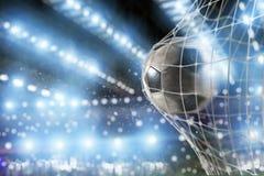 Soccer ball scores a goal on the net. Ball scores a goal on the net in a football match stock photo