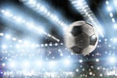 Soccer ball scores a goal on the net. Ball scores a goal on the net in a football match stock image