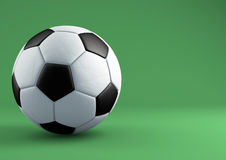 Soccer ball with shadows on green background. Royalty Free Stock Image