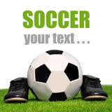 Soccer ball and shoes Royalty Free Stock Images