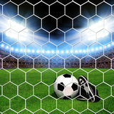 Soccer ball and shoes in grass Royalty Free Stock Photo