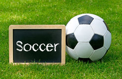 Soccer ball and sign on grass Stock Photography