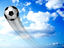 Soccer Ball In The Sky. Background of a soccer ball over a blue sky Royalty Free Stock Images