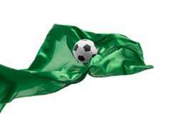 Soccer ball and Smooth elegant transparent green cloth isolated or separated on white studio background. Texture of flying fabric. Attributes of popular game royalty free stock image