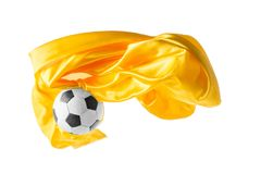 Soccer ball and Smooth elegant transparent yellow cloth isolated or separated on white studio background. Texture of flying fabric. yellow. Attributes of royalty free stock image