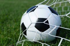 Soccer ball on soccer field Royalty Free Stock Photography