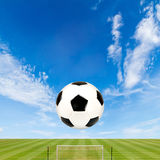 Soccer ball with soccer field against  blue sky Royalty Free Stock Image