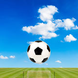 Soccer ball with soccer field against  blue sky Stock Photo