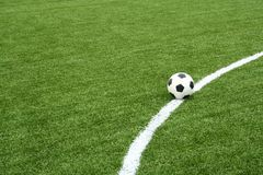 Soccer ball on soccer field with curve line Stock Images