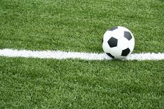 Soccer ball on soccer field with curve line Stock Photography