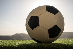 Soccer ball on soccer field. Football on green grass. Sunny background. Selective focus royalty free stock image