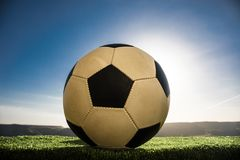 Soccer ball on soccer field. Football on green grass. Sunny background. Selective focus stock photos