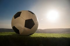 Soccer ball on soccer field. Football on green grass. Sunny background. Selective focus stock photography