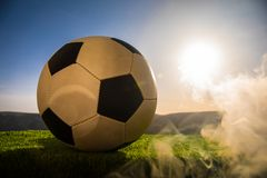 Soccer ball on soccer field. Football on green grass. Sunny background. Selective focus stock image