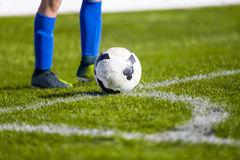 Soccer with ball on soccer field. Shooting a corner Royalty Free Stock Photography