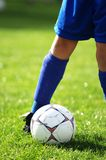Soccer ball and soccer player. In blue Royalty Free Stock Photography