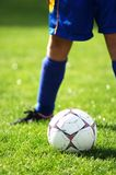 Soccer ball and soccer player 2. Soccer ball and soccer player in blue Stock Images