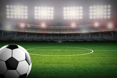 Soccer ball with soccer stadium background. 3d rendering soccer ball with soccer stadium background Royalty Free Stock Images