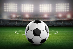 Soccer ball with soccer stadium background royalty free stock photos