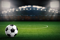 Soccer ball with soccer stadium background. 3d rendering soccer ball with soccer stadium background Royalty Free Stock Photos
