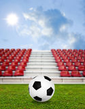 Soccer ball in sport arena with nice sky Stock Image
