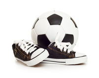 Soccer ball and sport shoes on white Royalty Free Stock Images
