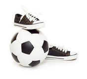 Soccer ball and sport shoes on white Royalty Free Stock Photography