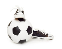 Soccer ball and sport shoes on white Stock Photography