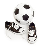 Soccer ball and sport shoes on white Stock Photos