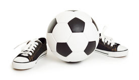 Soccer ball and sport shoes on white Royalty Free Stock Photo