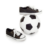 Soccer ball and sport shoes on white Stock Photo
