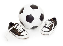 Soccer ball and sport shoes on white Stock Image