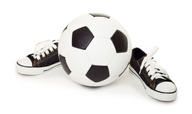 Soccer ball and sport shoes on white Royalty Free Stock Photos