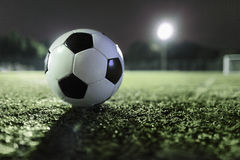 Soccer ball on sports field at night Stock Photography