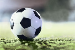Soccer ball on sports field at night Royalty Free Stock Photo