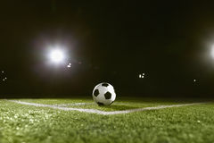 Soccer ball on sports field at night Royalty Free Stock Photography