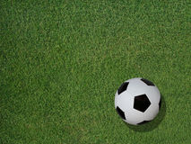 Soccer Ball on Sports Turf Grass. View of a classic soccer ball on green sports turf grass Royalty Free Stock Photo