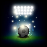 Soccer ball with spotlight Stock Images