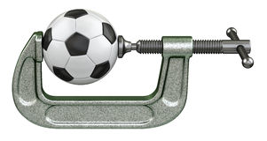 Soccer ball squeezing in a G-clamp Royalty Free Stock Photo